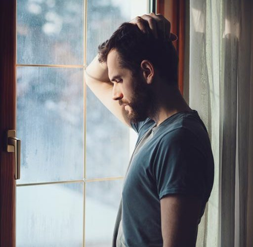 sobergrind-How-Enabling-Hurts-photo-of-depressed-man-near-the-window